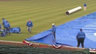 WGN Crews Pulling Away Tarp At Wrigley Field at Wrigley Field on April 08 2013 in Chicago Illinois