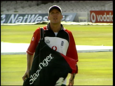 Cricket fixing inquiry LIB Former England cricket captain Alec Stewart towards across pitch in training kit