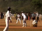 Cricket match, man batting, Mumbai, India