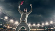 Cricket player is celebrating on the stadium