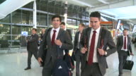 Cricketers Kevin Pieterson and Alastair Cook chat happily as they depart with rest of England team from Heathrow to India for oneday matches