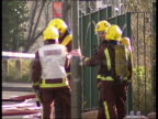 Cricklewood residents allowed to return home following gas canister scare ENGLAND London Cricklewood Close up fire engine by police cordon whisps of...