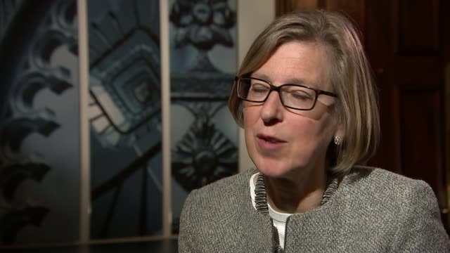 Crime across England and Wales rises by 13 per cent London INT Sarah Newton MP interview SOT Close shot of revolving sign 'New Scotland Yard'...