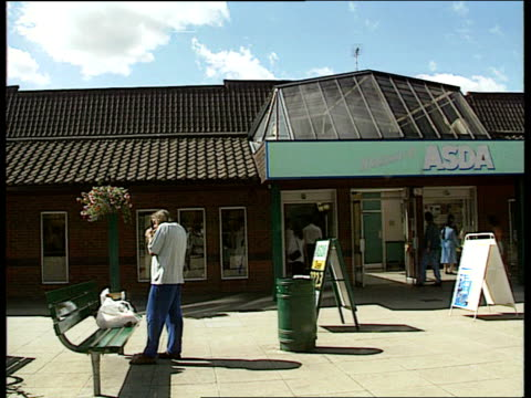 Asda Sewing Needles Found in Bread LIB ENGLAND Essex Chelmsford Sign 'Welcome to Asda' Customers to fro outside Asda store Woman pushing trolley full...