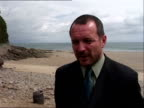 Child's body found on beach ITN WALES Pembrokeshire Hearse along Beach where body of 2yearold boy was found Police officers across beach PAN...