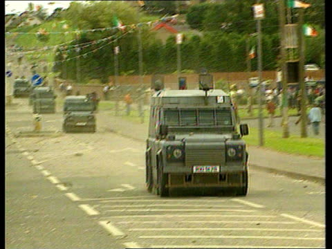Crime Drumcree march violence NORTHERN IRELAND Car slowly along country road PULL OUT vehicles ablaze in f/g CMS Flames rising LMS Blazing lorry...