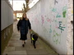 Rise in violent crime ITN Bruised face of blind mugging victim Cathy Todd EXT Cathy Todd towards past with guide dog INT 2 SHOT Cathy Todd interview...