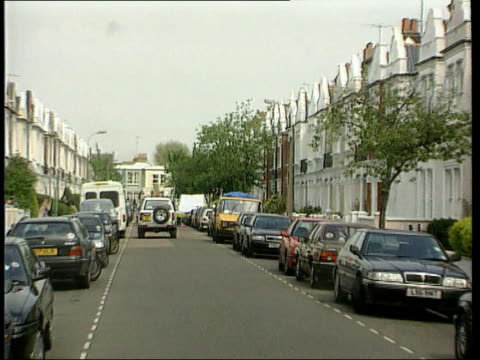 Jill Dando Murder Man Arrested then Released LIB ENGLAND London Fulham Police officer speaking to people on street where murdered TV presenter Jill...