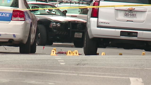 WGN Crime Scene Markers and Yellow Tape in Downtown Dallas near El Centro College on July 9 2016 On July 7 at the end of a 'Black Live Matter'...