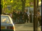 Shooting Incident in Feltham ITN ENGLAND London Feltham shaky camera GV Armed police putting on body armour outside flat where gunman is hiding
