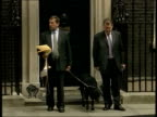 Drugs Cannabis downgraded to class C ITN Downing Street Home Secretary David Blunkett MP with guide dog outside Number 10 ZOOM IN