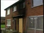Crime/Terrorism 56th arson attack on family NORTHERN IRELAND Belfast LA Grille over burnt out windows PULL OUT burnt house LMS More ditto MS Boarded...