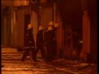 Crime/Terrorism Fire Bombs N IRELAND GV Smoking remains of store N Belfast LS Firemen damping down debris BampQ store GV Smoking remains with water...