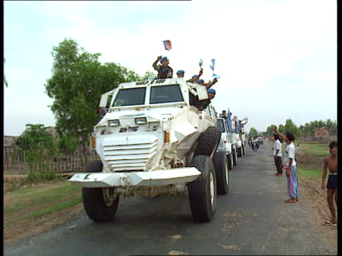 Six peacekeepers held by Khmer Rouge CF TAPE NO LONGER AVAILABLE cNAO CAMBODIA LMS Convoy of UN APC's towards waving flags R27049217 ITN TX CAMBODIA...