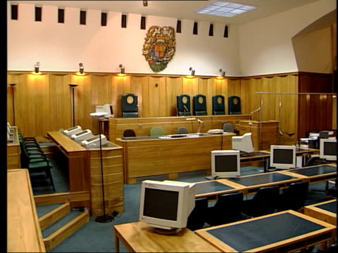 reform plans revealed LIB GV Empty courtroom PAN Microphone PULL FOCUS coat of arms on wall Barrister's wig on desk TILT UP court room