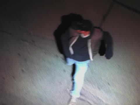 Criminal running from overhead spotlight