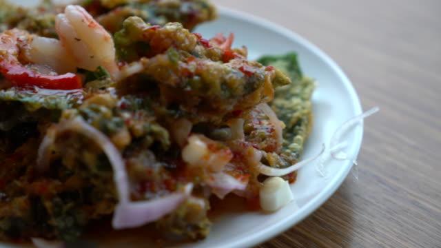 Crispy deep fried morning glory salad with shrimp