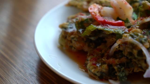 Crispy deep fried morning glory salad with spicy sauce