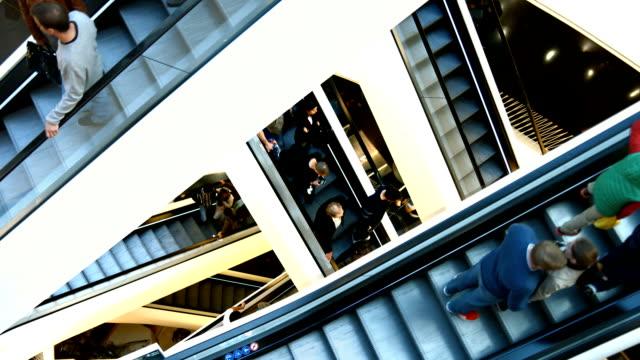 Criss Cross Escalators In Modern Shopping Mall (4K/UHD to HD)