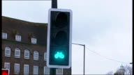 Criticism of new traffic light safety measure for cyclists ENGLAND London Bow Roundabout EXT Reporter to camera Andrew Gilligan interview SOT New...
