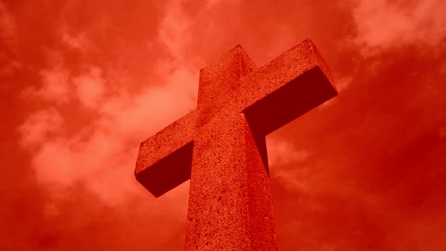 Cross against red sky  (Time Lapse)