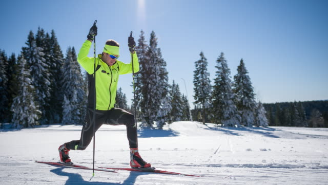 Cross country skier doing lunges and getting ready for the competition
