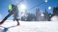 Cross country skier skate skiing uphill