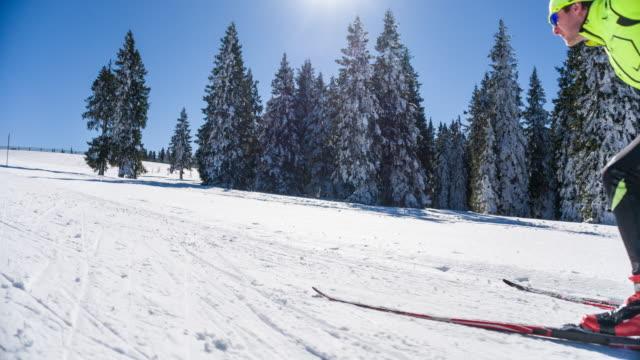 Cross country skier skate skiing uphill