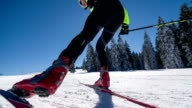 Cross country skier skate skiing uphill, warming up