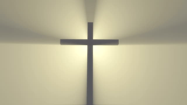 Cross in the fog with beams of light