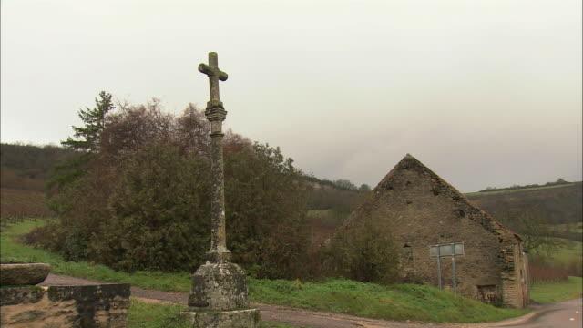 WS Cross monument in village / Burgundy, France