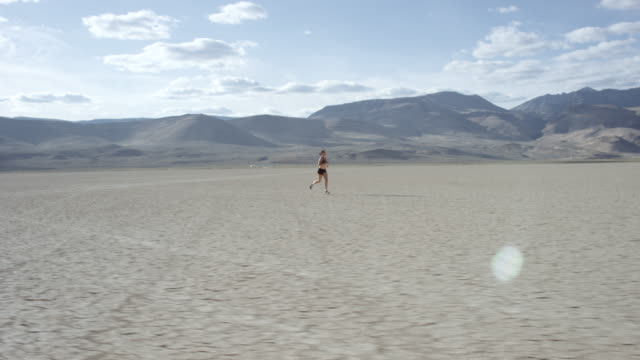 Crossing In Front of a Woman Running in the Desert