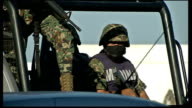 Crossroads in Mexican war on drugs MEXICO Acapulco EXT General views of armed Mexican Marines patrolling on truck Armed Marines on military truck...