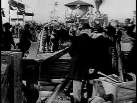 REENACTMENT Crowd cheering at approaching steam engine during recreation of 1869 Golden Spike ceremony / Promontory, Utah, United States