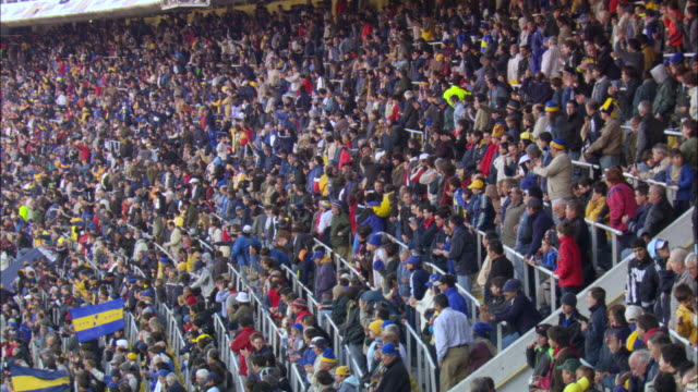 WS PAN TU Crowd cheering at stadium / Buenos Aires, Argentina