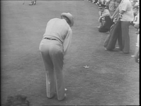 Crowd gathered around a golf course near a sandpit / Sammy Snead teeing off / Jimmy Turnesa teeing off / Turnesa and Snead walking with a group /...