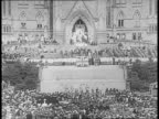 Crowd having Mass on Parliament Hill / group of officials / Protestant service cross and altar / altar boys turning around / crowds / National War...