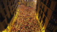 WS TU Crowd in Plaza de Consistorial and town hall at Pobre De Mi closing ceremony of festival of San Fermin / Pamplona, Navarre, Spain