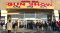 Crowd Lines Up to Enter the Building at The Nation's Gun Show at the Dulles Expo Center on December 28 2012 in Dulles Virginia