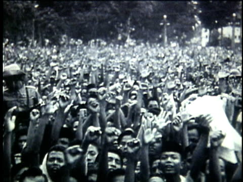 Crowd of cheering supporters of Indonesian President Sukarno / Indonesia