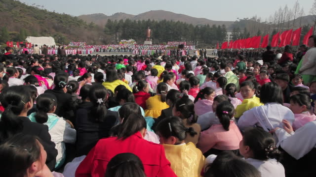 A crowd of Koreans sits down during the celebrations on the 100th anniversary of the birth of President Kim IL Sung in Pyongshong, a satellite city outside of Pyongyang, North Korea.