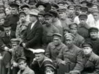 MS Crowd of men Trotsky Sverdlov and Zinovyev meet workers Trotsky talking to man in crowd Trotsky and Zinovyev pose for camera with crowd AUDIO/...