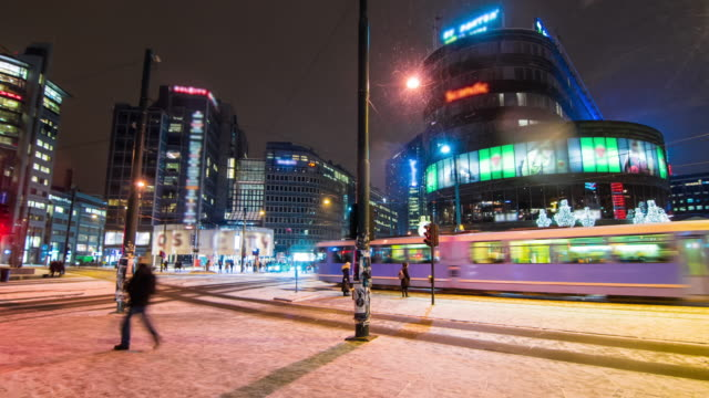 Crowd Of Pedestrians At Night In The Commercial District Of Oslo, Norway