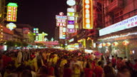 T/L MS Crowd of people at Chinatown street festival at night, Bangkok, Ayuthaya, Thailand