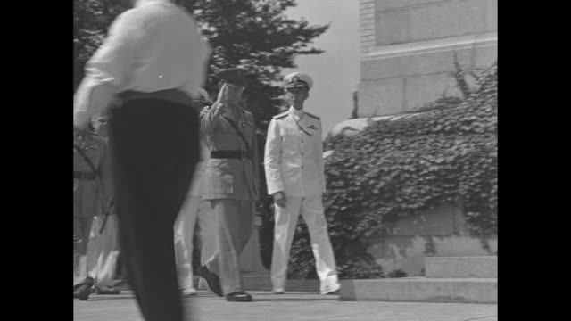 Crowd of people entering church at US Naval Academy / King George II of Greece Admiral John Beardall and entourage approach church steps during the...