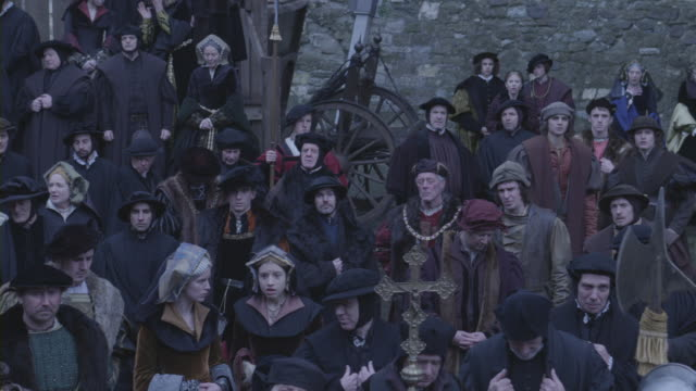 A crowd of people in Renaissance clothing.