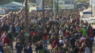 WS, HA, Crowd of people walking around an outdoor event, California, USA