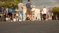 Crowd Of People Walking Down The Street