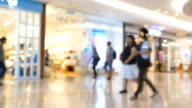 Crowd of Shoppers in a Busy Shopping Mall