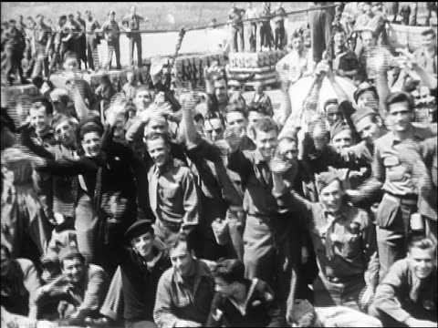 B/W 1945 crowd of soldiers waving on deck of ship / newsreel